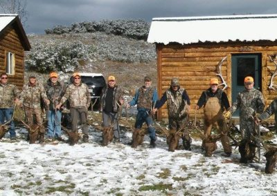 Hunters with all of their elk at Wolf Mountain Ranch