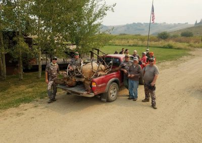 Hunters and guides gather around truck with all of their Elks