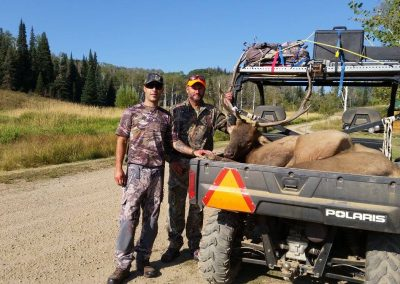 Hunters with their Elk in the back of a Polaris