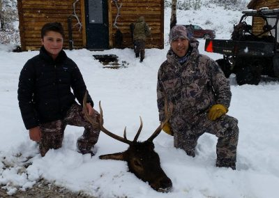 Hunter in the snow with their Elk