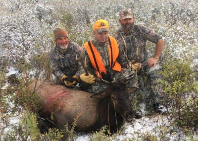 Hunters with their kill at Vanatta Outfitters