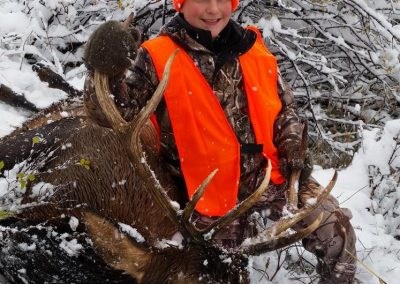 Kid hunter with his deer